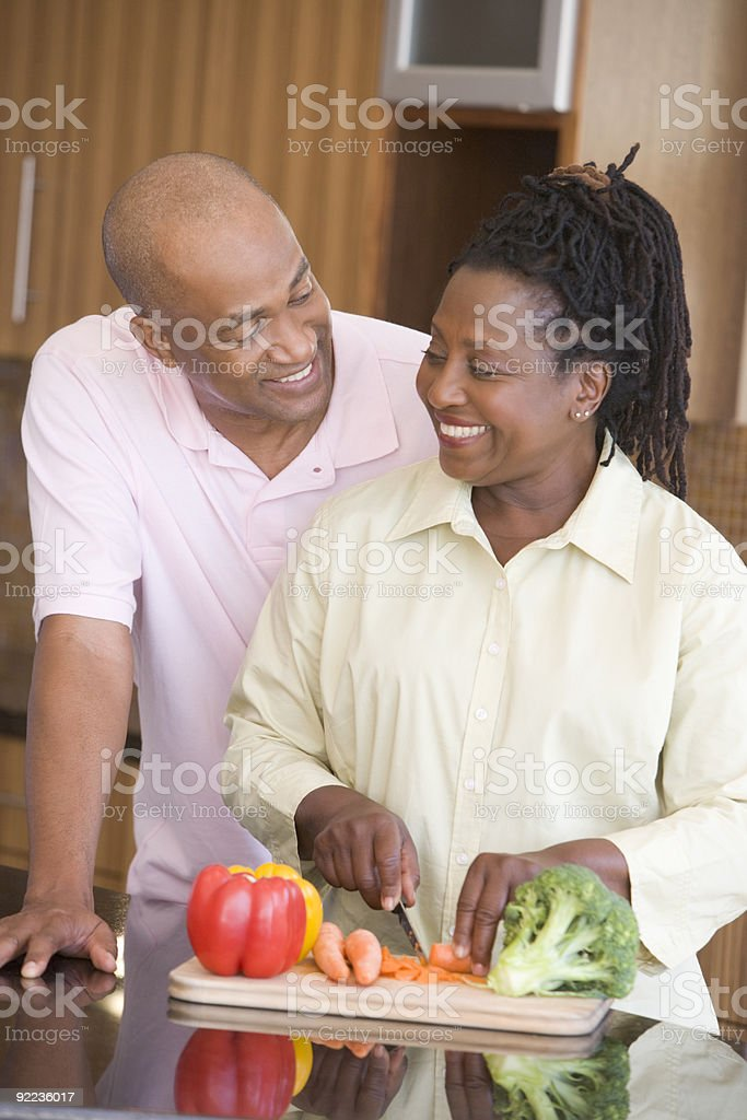 Husband And Wife Preparing A meal royalty-free stock photo