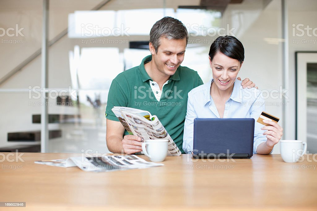 Husband and wife sitting with packages stock photo
