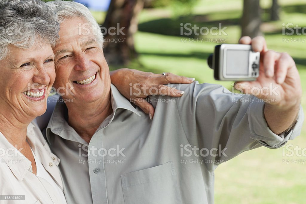 Husband and wife taking a picture of themselves royalty-free stock photo