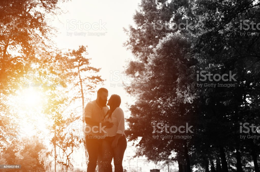 husband and wife walking in park stock photo