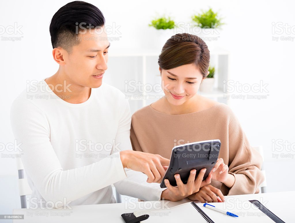 husband and wife with family finance concept stock photo