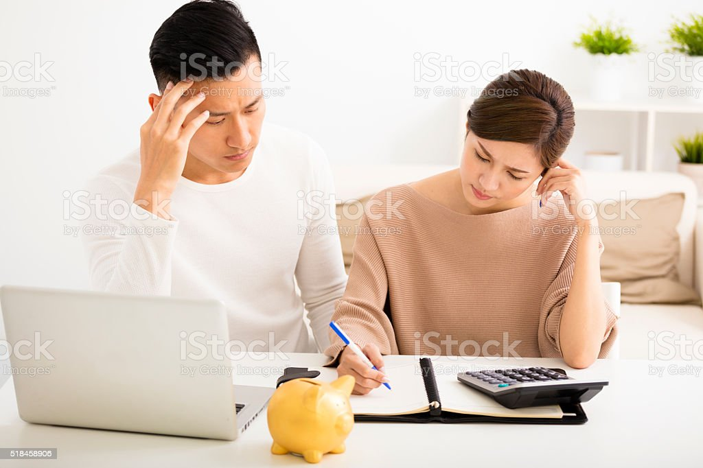 husband and wife with financial stress stock photo
