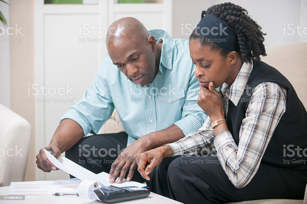 Husband and Wife Working on Their Budget stock photo