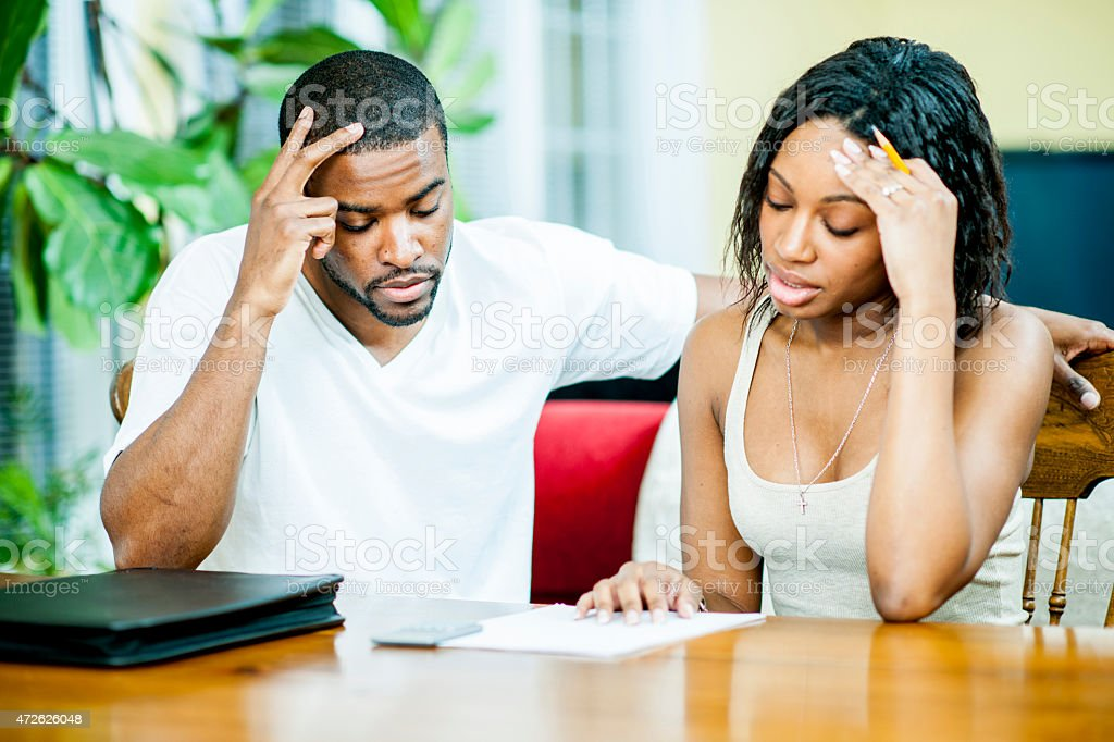 Husband and wife Worried about their Finances stock photo