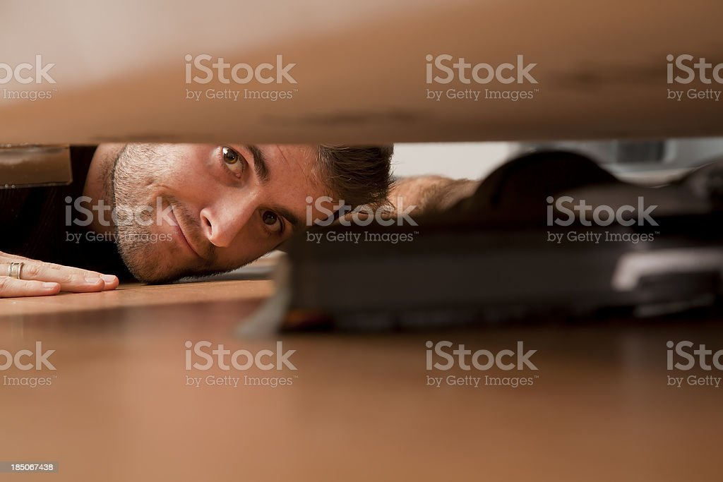 husband cleaning under the chair stock photo