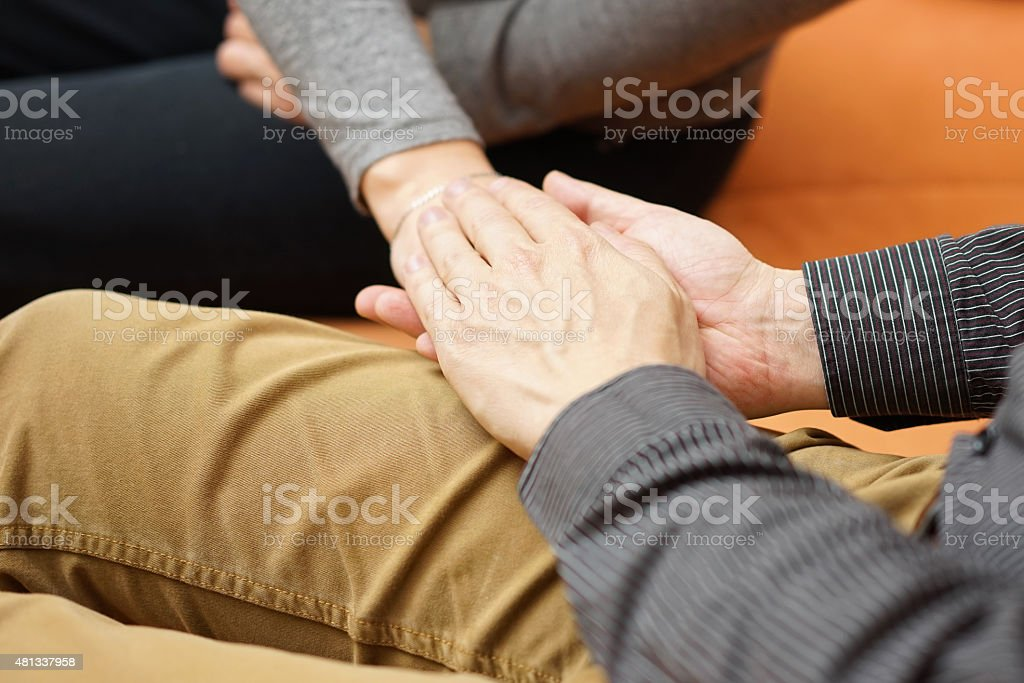 husband holding hands of her wife stock photo