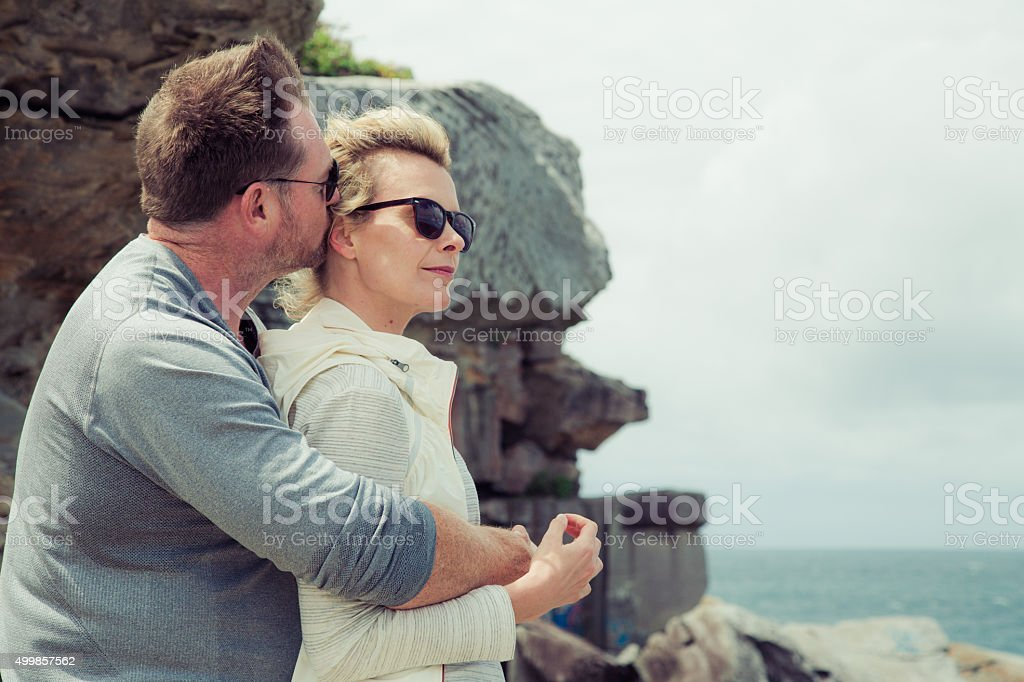 Husband kissing wife stock photo