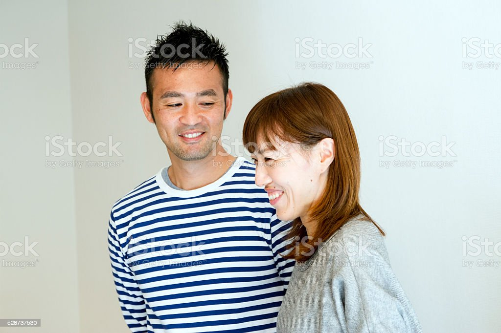 Husband looking at smiling his wife stock photo