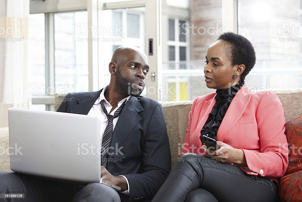 Husband looks to wife for her approval royalty-free stock photo