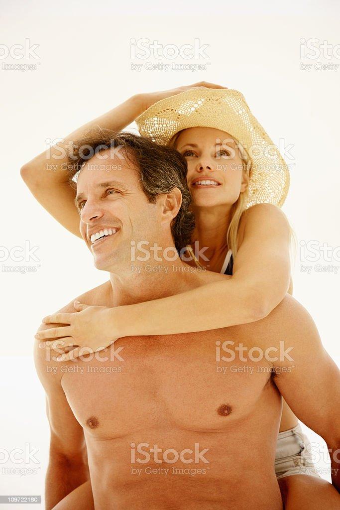 Husband piggybacking his wife royalty-free stock photo