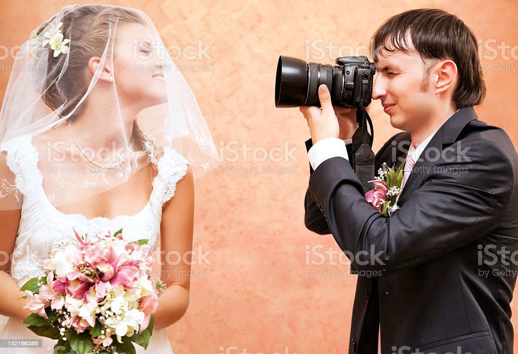 Husband taking picture of his wife royalty-free stock photo