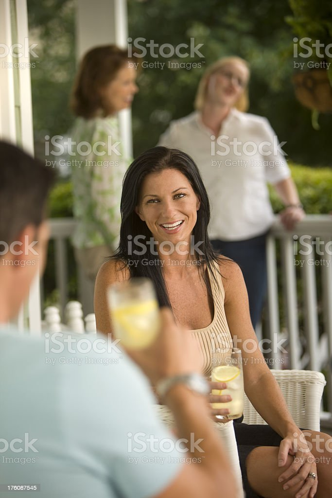 Husband toasting his beautiful wife with a glass of lemonade. royalty-free stock photo