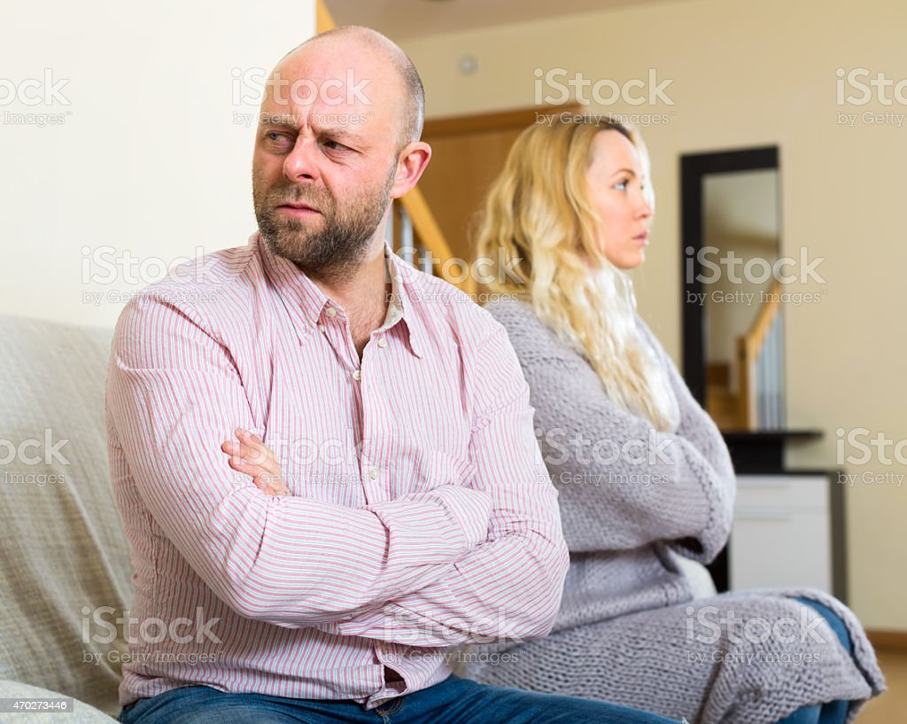 Husband turned away from his wife stock photo
