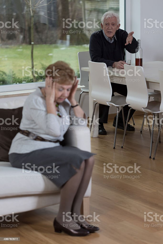 Husband yells at his wife stock photo
