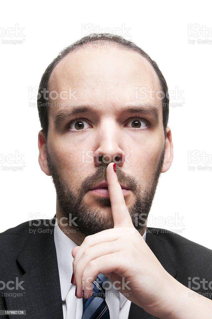 Hush up - woman's hand shutting-up a businessman stock photo
