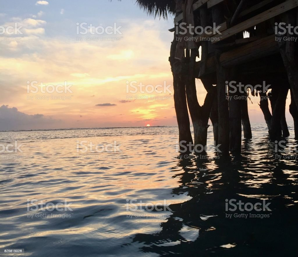 Hut at sea sunset stock photo
