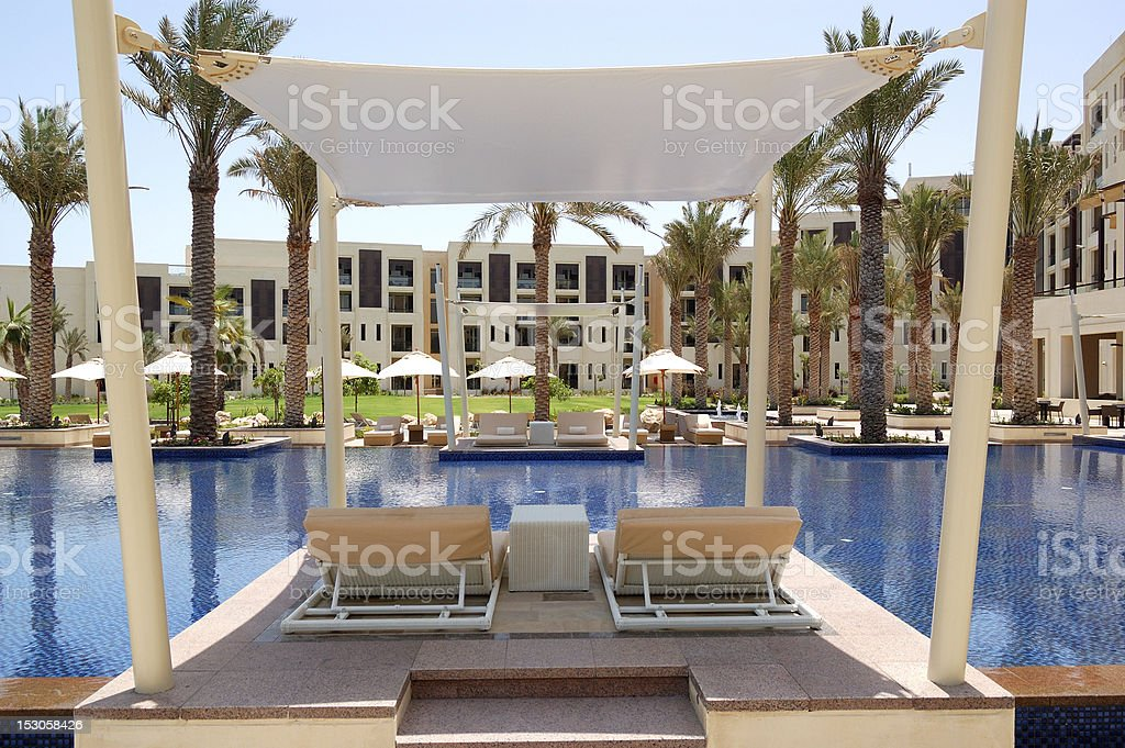 Hut at swimming pool of the luxury hotel stock photo