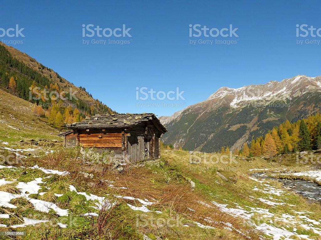 Hut in fall at the Alps stock photo