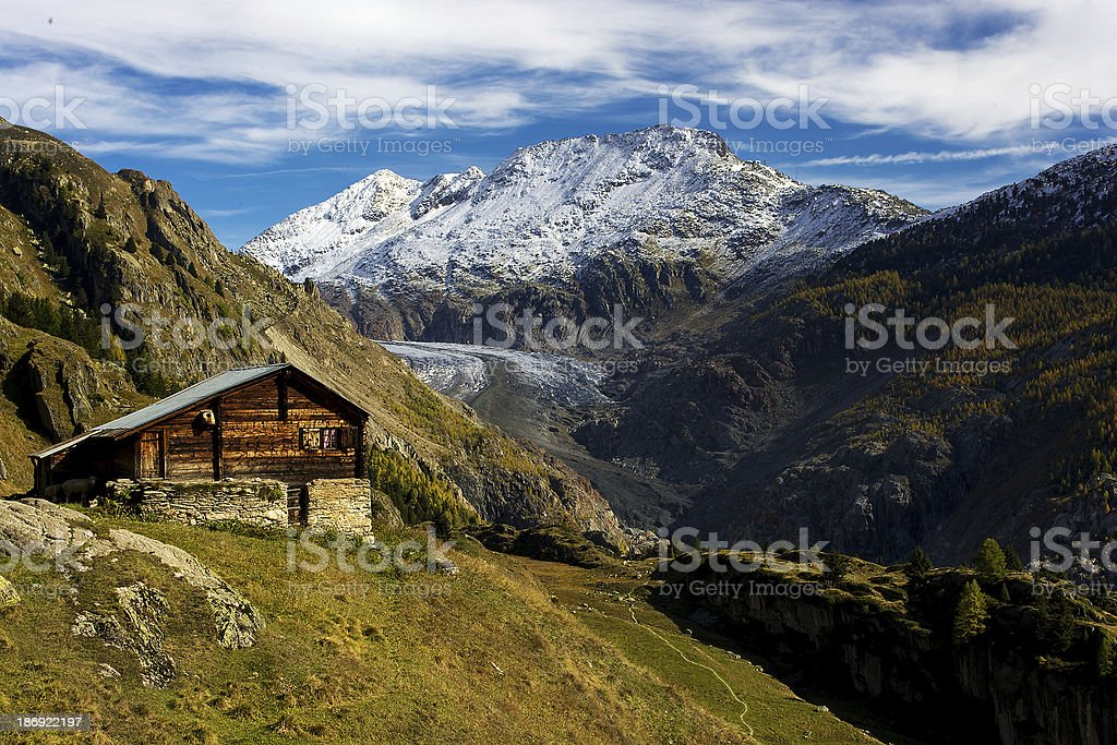 Hut In Front Of The Aletsch Glacier stock photo