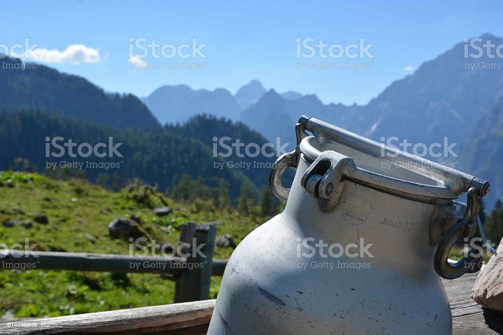 Hut in german alps with milk can stock photo
