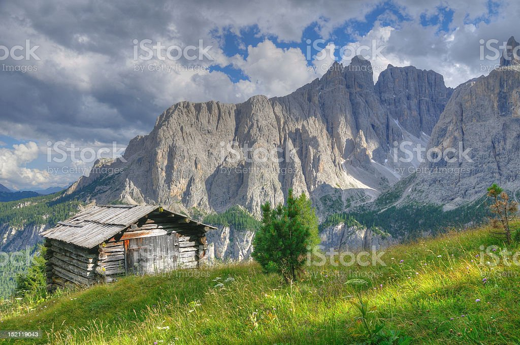 Hut in mountain landscape dolomites stock photo