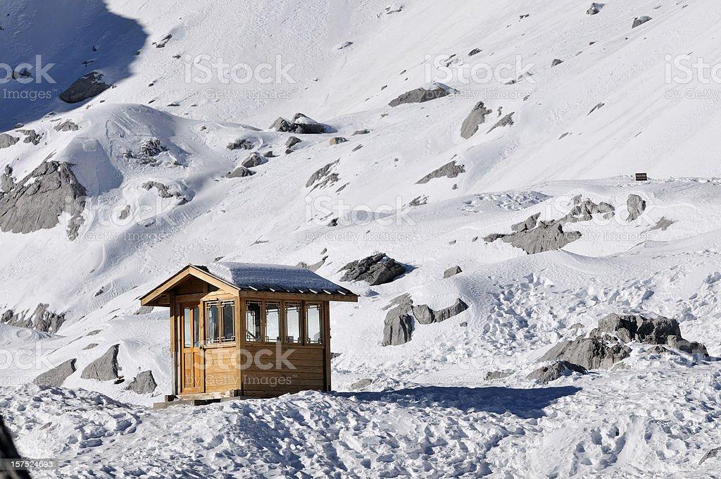 Hut in snow mountain stock photo