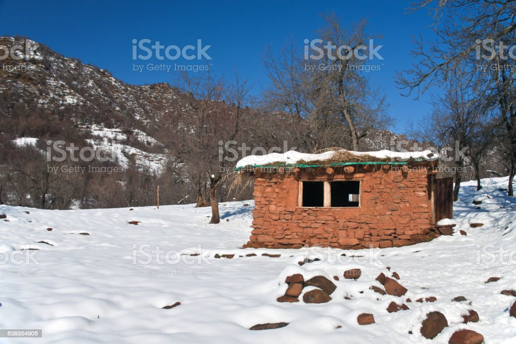 Hut in the mountains of Tajikistan stock photo