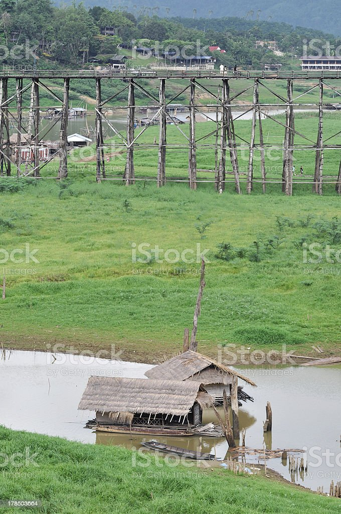 Hut raft floating on river with bamboo bridge royalty-free stock photo