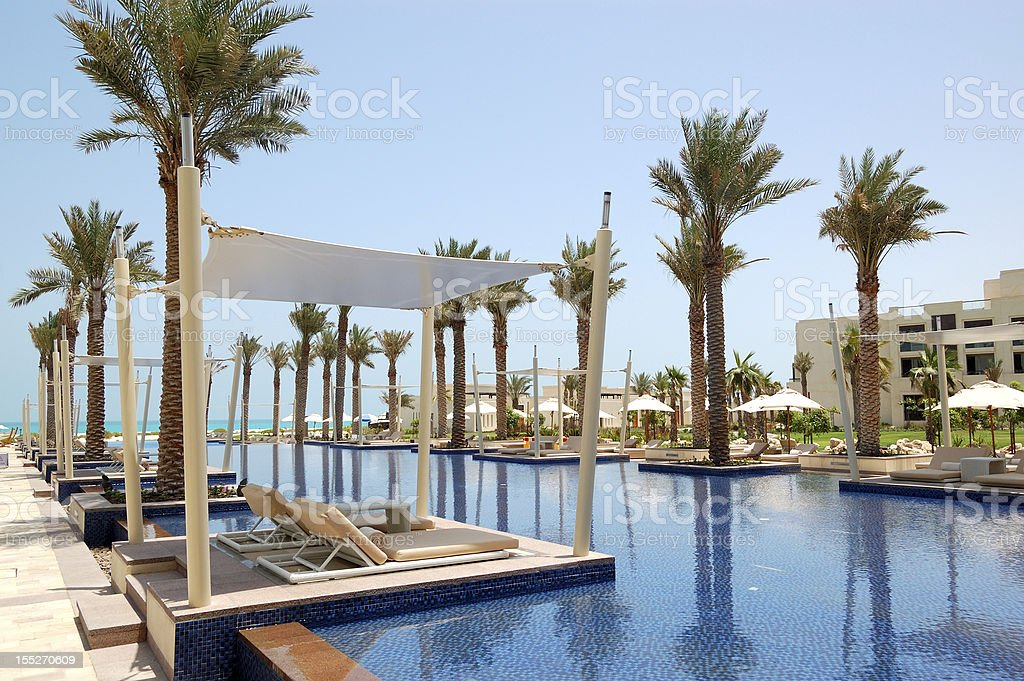 Huts at swimming pool of the luxury hotel stock photo