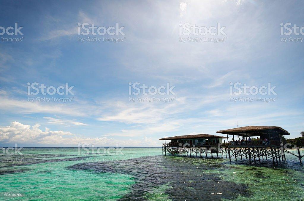 Huts on stilts Mantanani Island Borneo stock photo