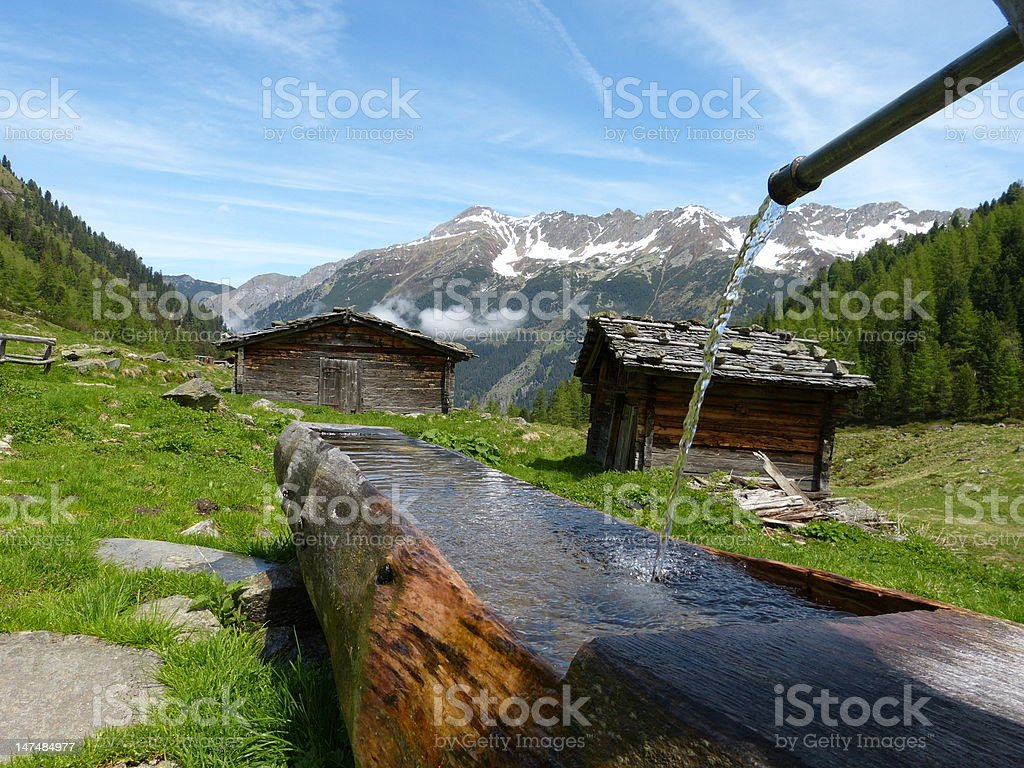 Huts with wooden well stock photo