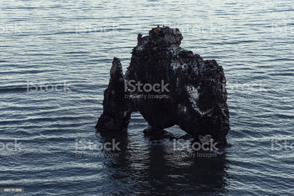 Hvitserkur, basalt stack at the eastern shore of the Vatnsnes peninsula, in northwest Iceland.This stack has shape of a dragon or an elephant stock photo