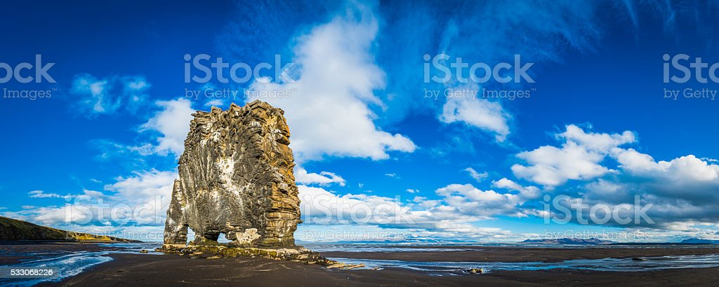 Hvitserkur iconic volcanic sea stack on black beach panorama Iceland stock photo