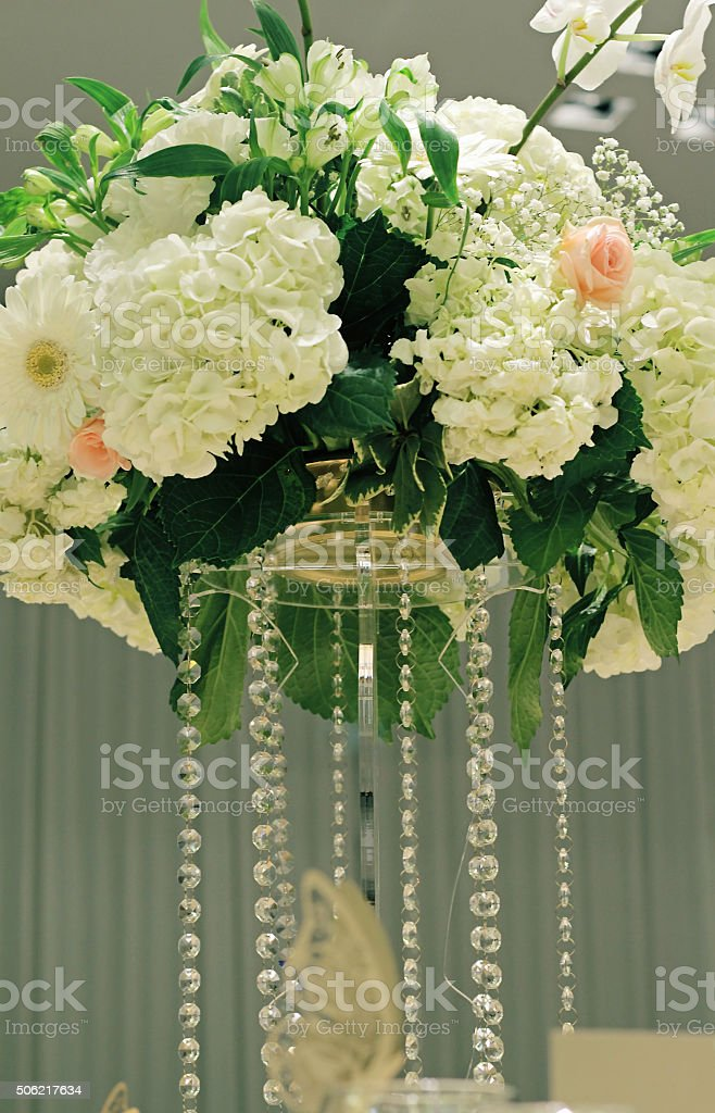 Hydrangea, roses and orchid wedding table bouquet. stock photo