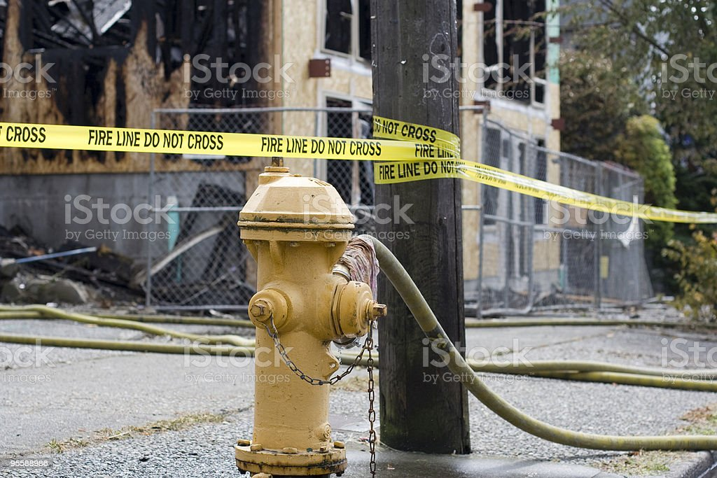 Hydrant and fire line do not cross tape royalty-free stock photo