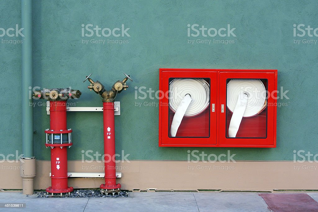 Hydrant with water hoses and fire extinguish equipment royalty-free stock photo