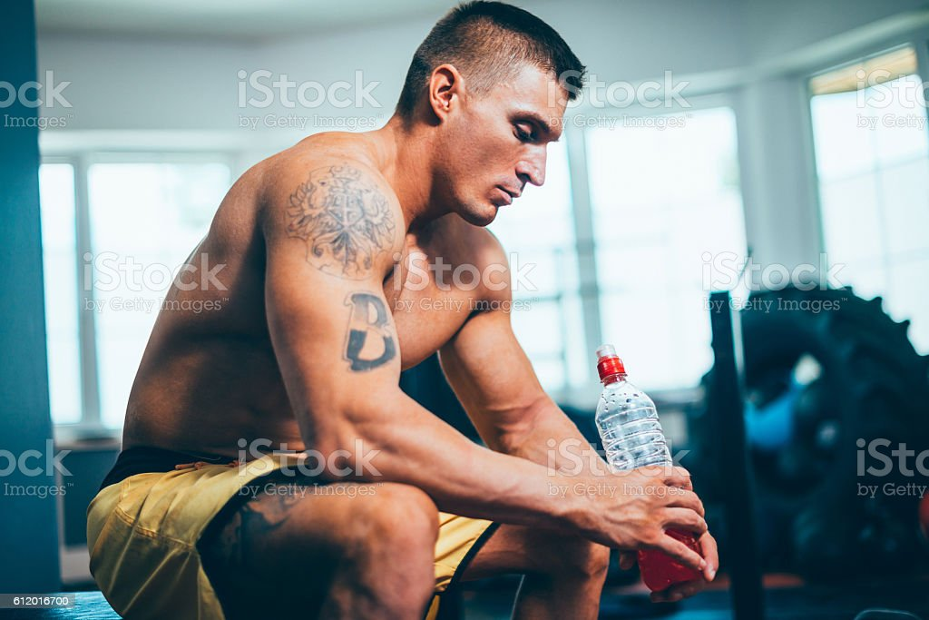 Hydration with energy drink after cross training stock photo