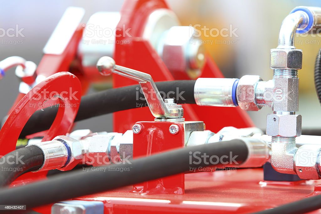 Hydraulic connections of a machinery industrial detail stock photo