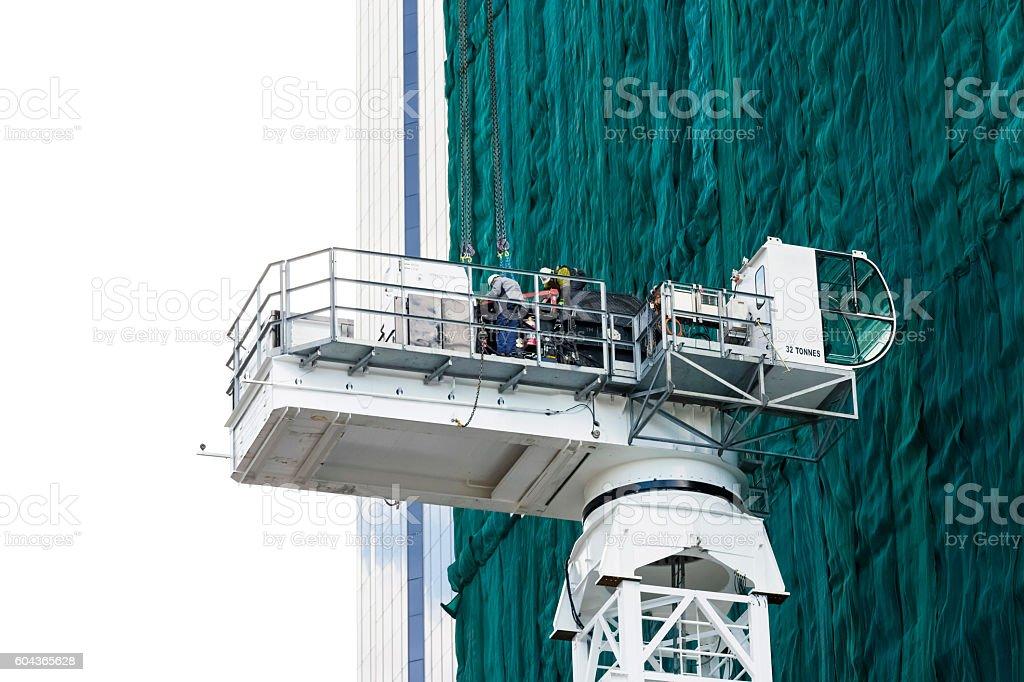 Hydraulic construction platform at skyscraper renovation, copy space stock photo