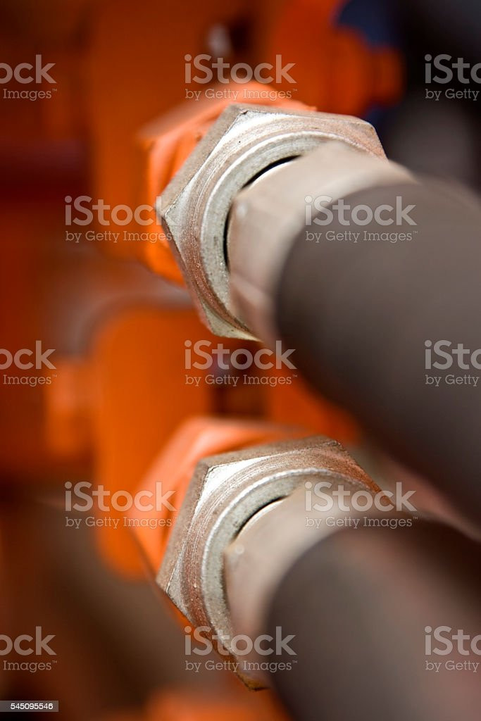 Hydraulic Couplings and Hoses, Silver Black and Orange stock photo