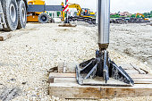 Hydraulic crane foot is supported by wood for safety,
