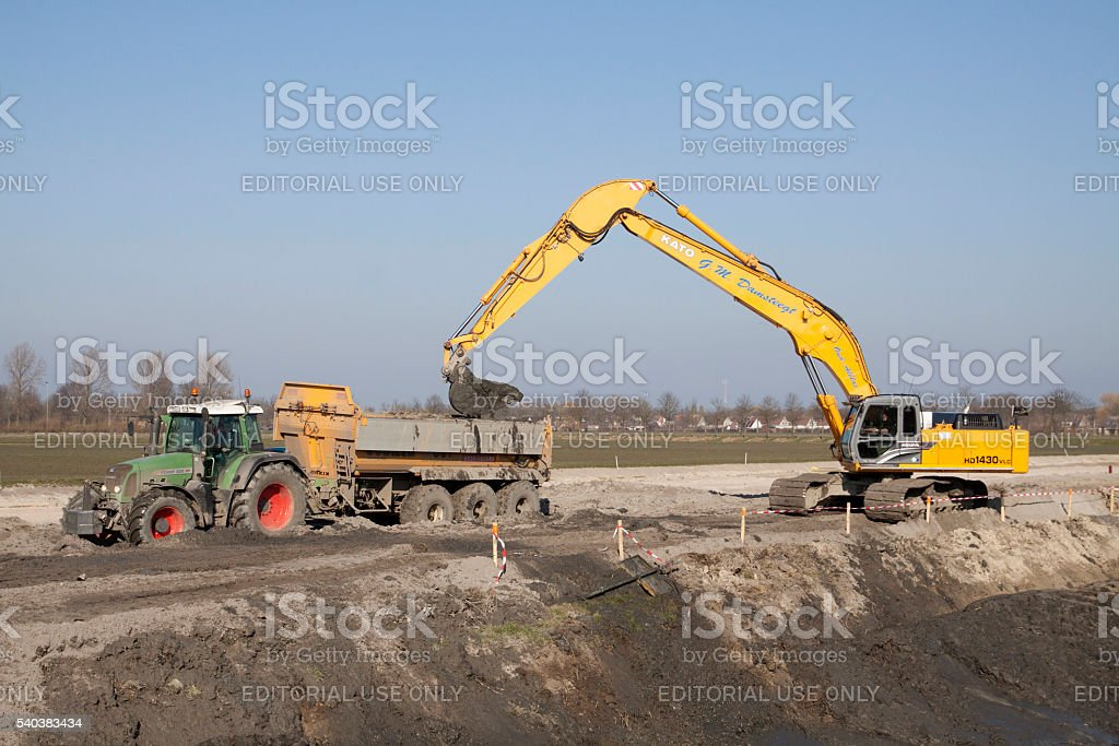 Hydraulic crane in action stock photo
