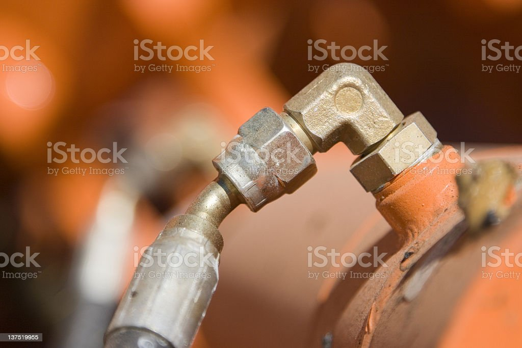 Hydraulic Elbow Component, Cylinder and Hose stock photo