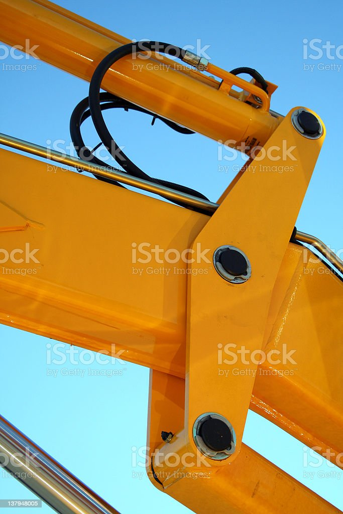 Hydraulic element of a yellow tractor royalty-free stock photo