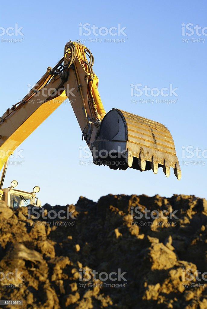 Hydraulic excavator at work royalty-free stock photo