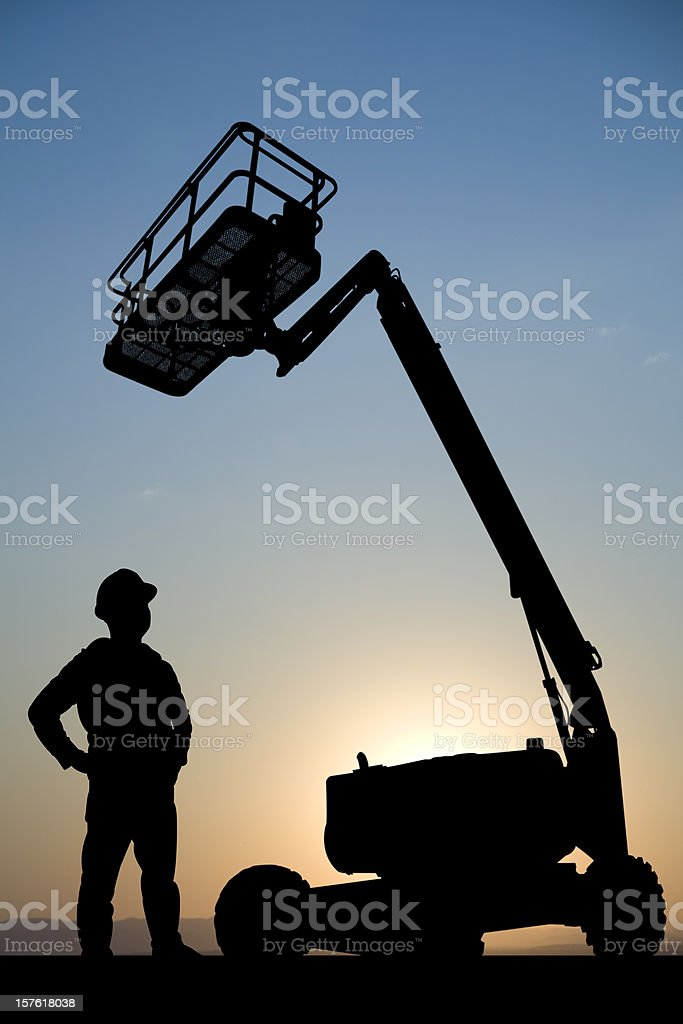 Hydraulic Lift and Construction Worker royalty-free stock photo