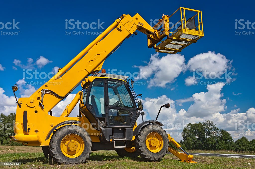 Hydraulic lifts against blue skies stock photo