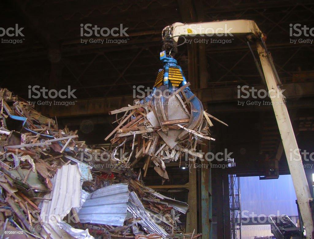 hydraulic peel grab loading scrap stock photo