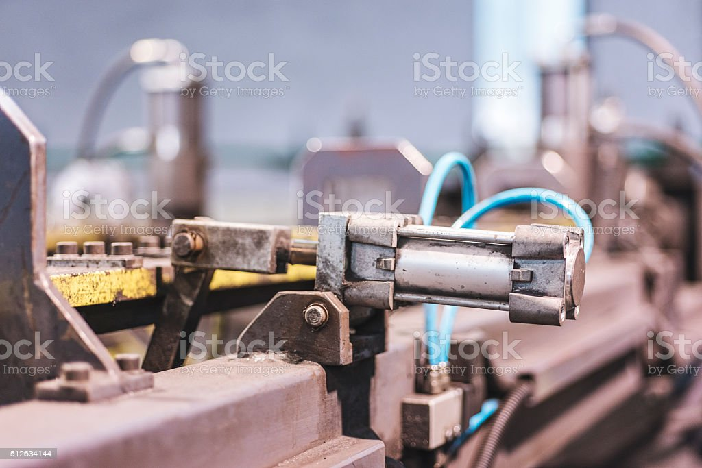 hydraulic piston on factory machine stock photo