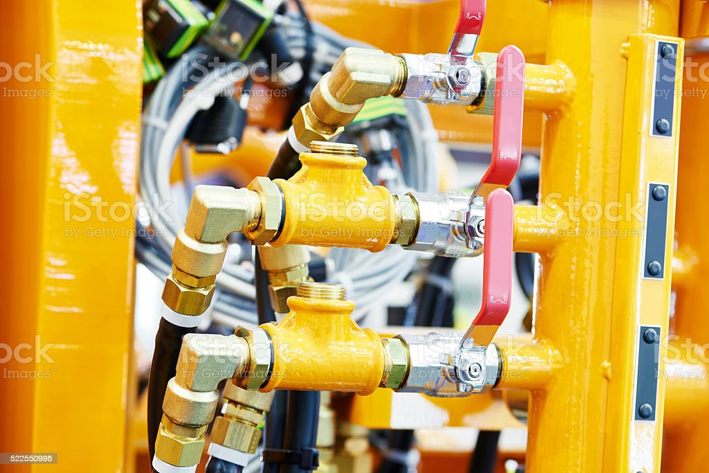 Hydraulic pressure pipes and connection fittings of industrial equipment stock photo